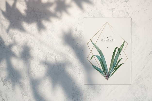Premium quality card mockup with leaves and golden frames Free Psd