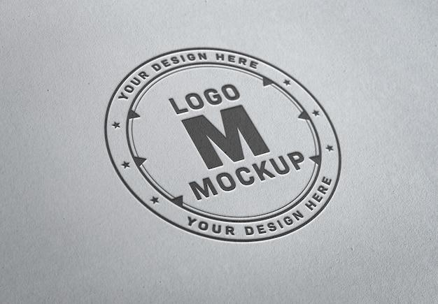 Pressed logo mockup on white paper texture Premium Psd