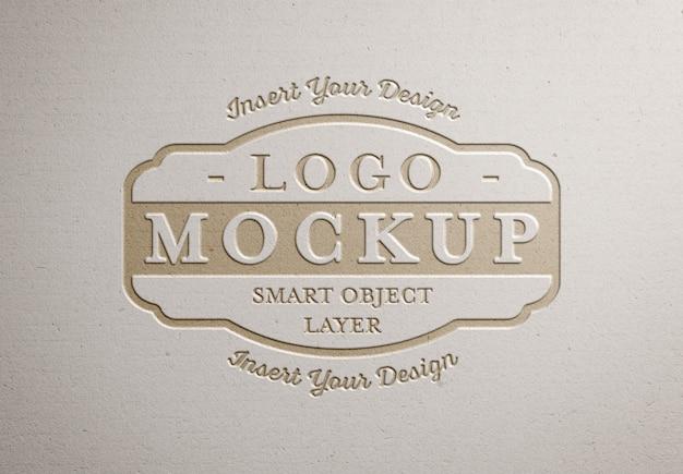Pressed logo  on white paper texture Premium Psd