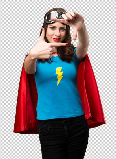 Pretty superhero girl focusing with her fingers Premium Psd