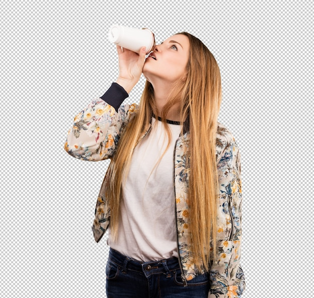 Pretty young woman having a coffee Premium Psd