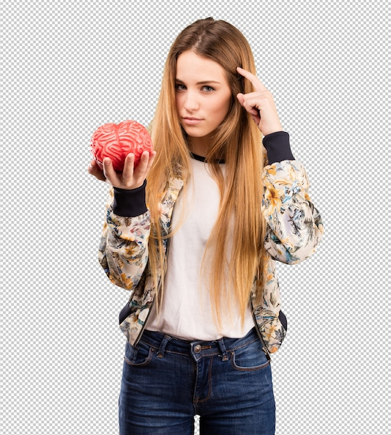 Pretty young woman holding a brain object Premium Psd