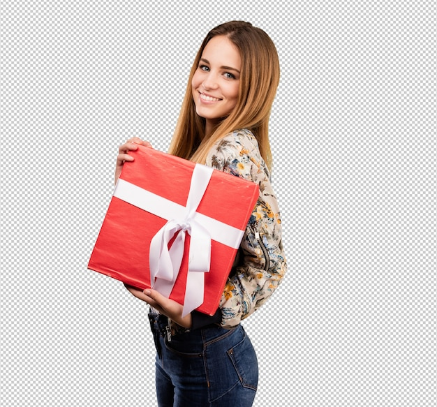Pretty young woman holding a gift Premium Psd