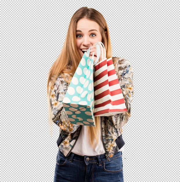 Pretty young woman holding shopping bags Premium Psd