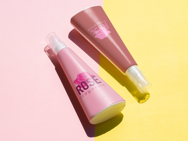 Product design with pink bottles mock-up Free Psd