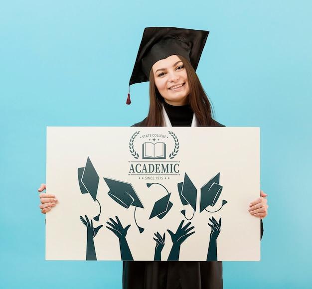 Proud university student holding mock-up sign Free Psd
