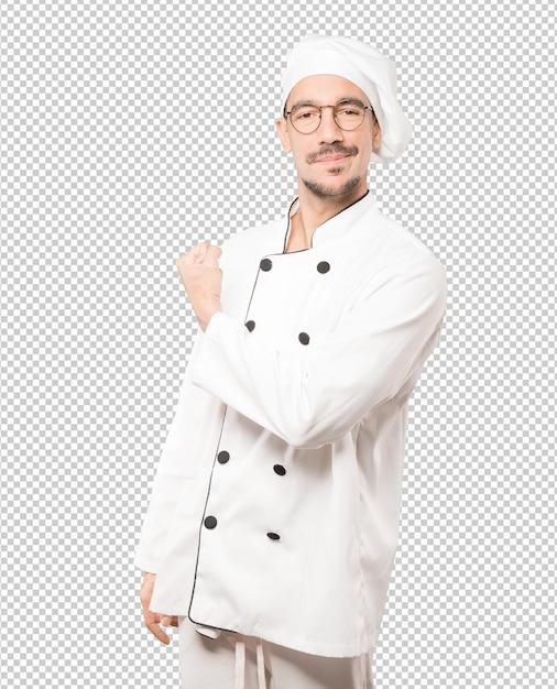 Гордый молодой шеф-повар делает жест рукой своей рукой Premium Psd