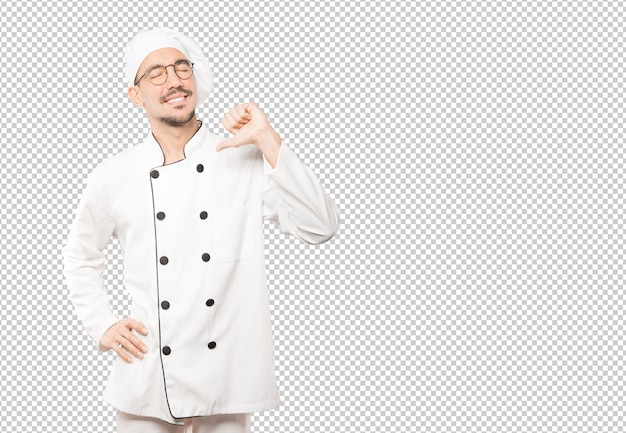 Proud young chef making a haughty gesture Premium Psd