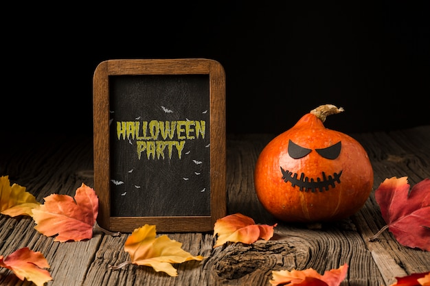 Pumpking and halloween board with message Free Psd