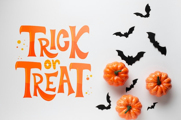 Pumpkins and bats for halloween day Free Psd