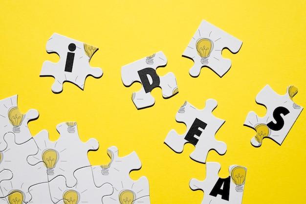 Концепция головоломки с буквами и лампочками Бесплатные Psd