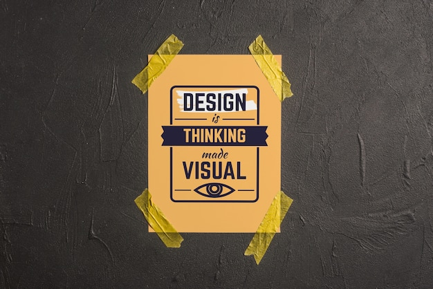 Quote or lettering mockup on poster pasted at wall Free Psd