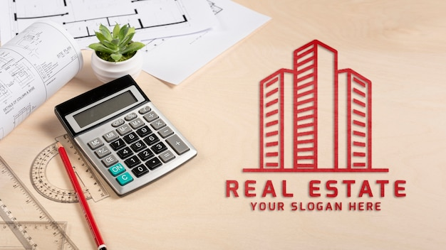 Real estate logo with calculator Free Psd