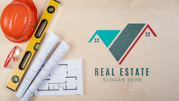 Real estate logo with equipment Free Psd