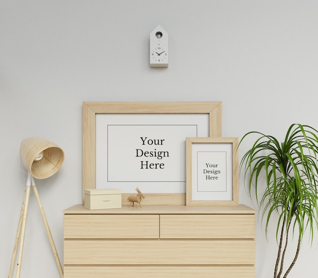 Realistic double poster frame mock up design template sitting on a drawer in modern interior Premium Psd
