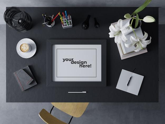 Realistic single artwork frame mock up design template resting landscape on black table in modern interior workspace Premium Psd