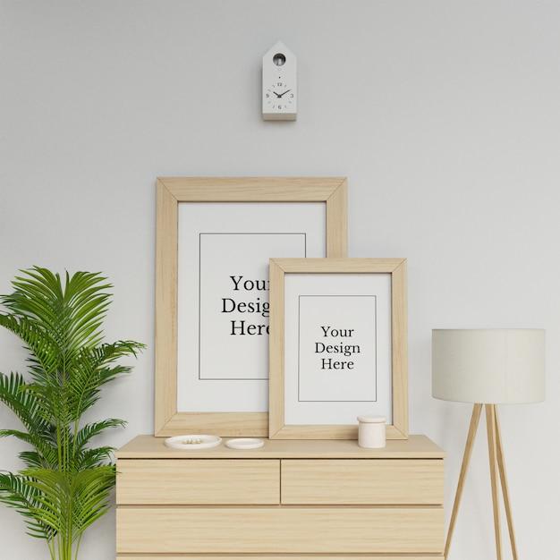 Realistic two poster frame mockup design template sitting portrait in scandinavia interior Premium Psd