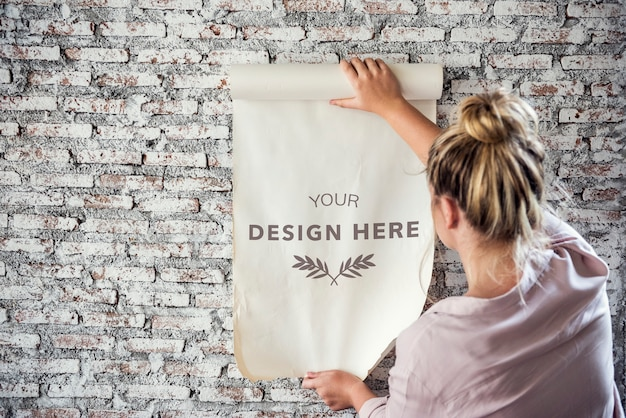 Rear view of woman holding design space paper Premium Psd