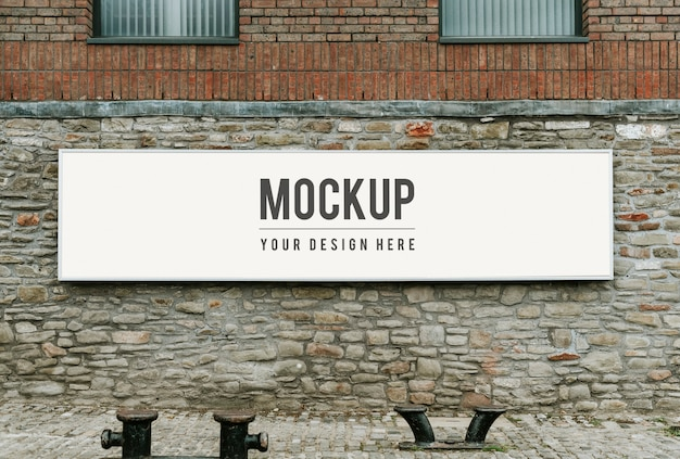 Rectangular public signage mockup on a brick wall Free Psd