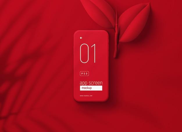 Mockup di smartphone rosso con foglie rosse Psd Gratuite