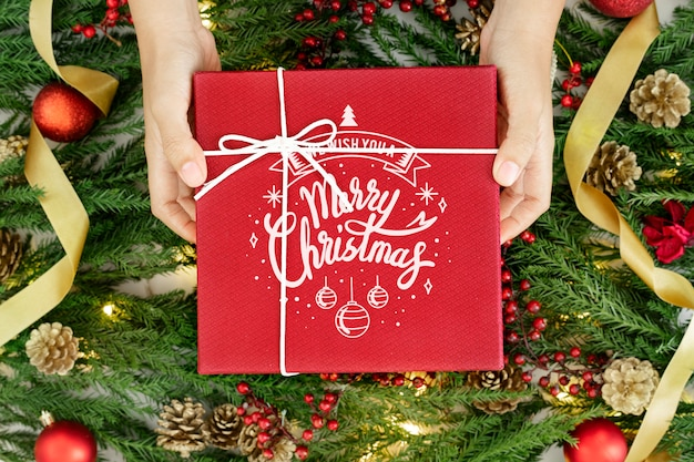 Red wrapped christmas present mockup Free Psd