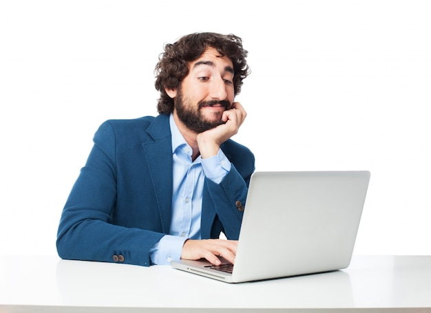 Relaxed businessman typing on his computer Free Psd