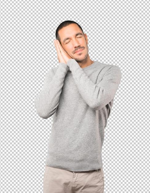 Расслабленный молодой человек, делая жест сна Premium Psd