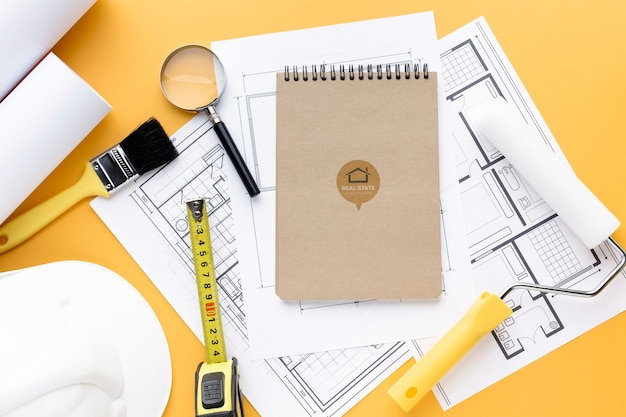 Repairing tools with notepad mock-up on orange background Free Psd