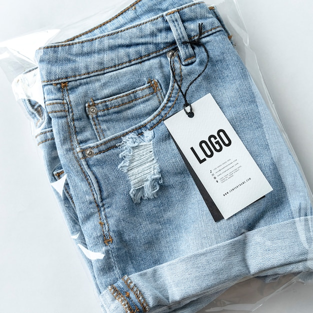 Ripped jean shorts with a tag mockup Free Psd