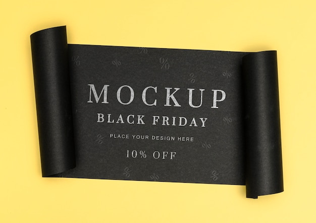 Rolled banner of yellow background black friday sales mock-up Free Psd