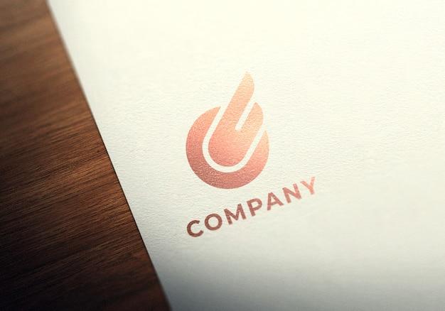 Макет логотипа из розового золота на фактурной бумаге Premium Psd