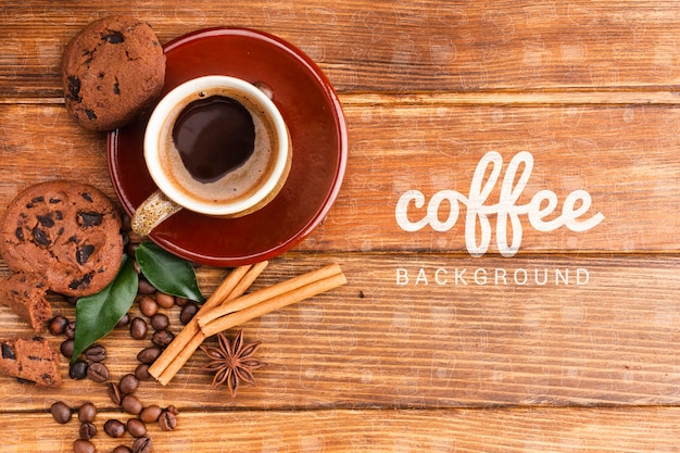 Rustic background with coffee cup and cookies Free Psd