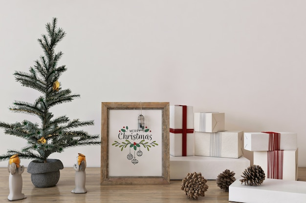 Rustic frame poster mockup in christmas concept with christmas tree and decoration Premium Psd
