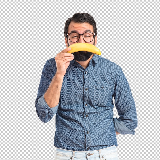 Sad young hipster man with banana Premium Psd