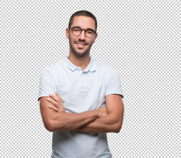 Satisfied young man with crossed arms gesture Premium Psd