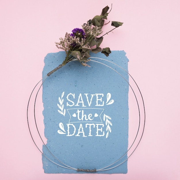 Save the date mock-up on blue paper and dried flowers Free Psd