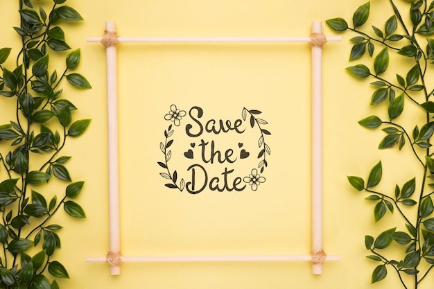 Save the date mock-up frame with small branches with leaves Free Psd