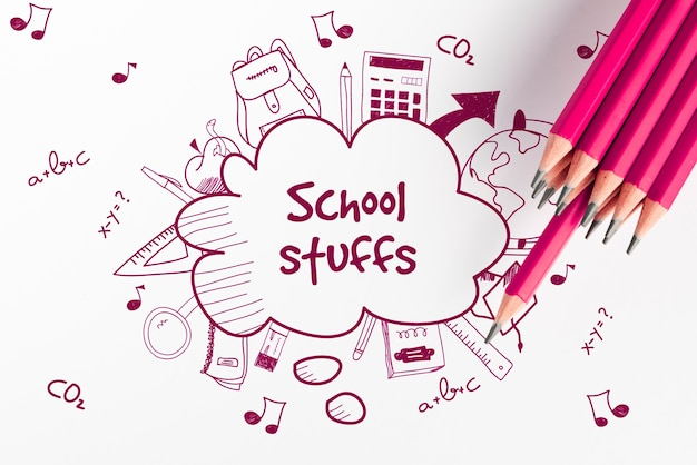 School stuff doodle sketches and pink pencils top view Free Psd