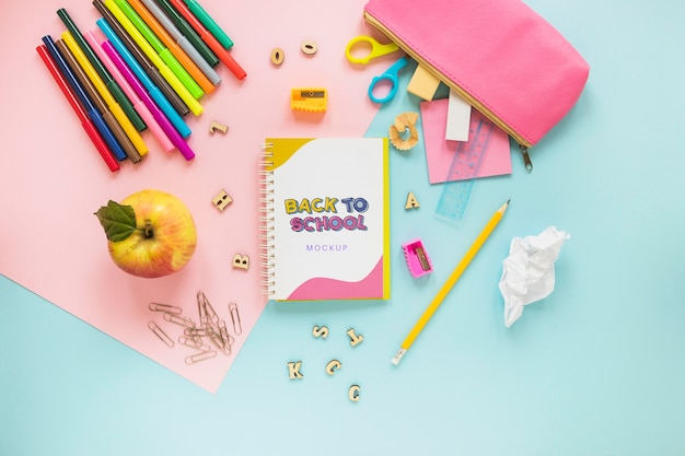School supplies on blue background Free Psd