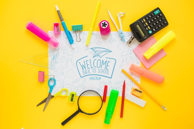 School supplies on yellow background Free Psd