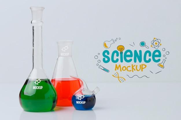 Компоновка элементов науки с макетом стены Бесплатные Psd