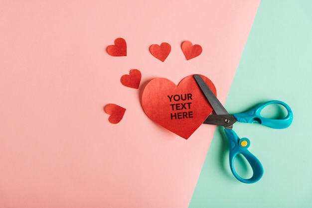 Scissors with paper in heart shapes and copy space Free Psd