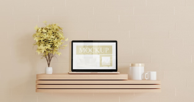 Screen laptop mockup on the wooden mini table with couple decorative plants Premium Psd