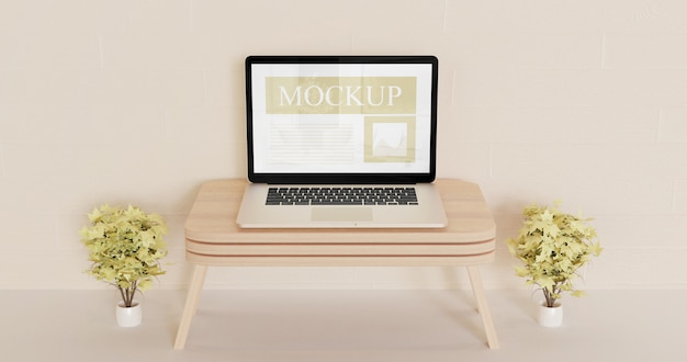 Screen laptop mockup on the wooden wall desk with decorative brown plants Premium Psd
