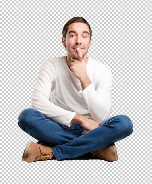Seated young man wondering Premium Psd