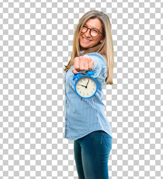 目覚まし時計を持つシニアの美しい女性 Premium Psd