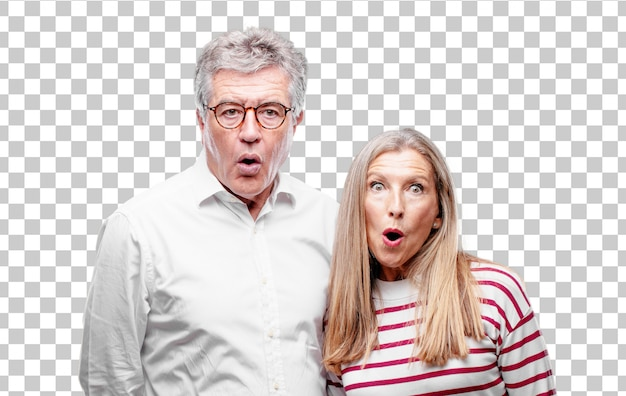 Senior cool husband and wife with a surprised, amazed expression and mouth wide open in shock. Premium Psd
