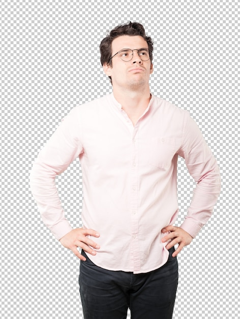 Serious young man looking up gesture Premium Psd