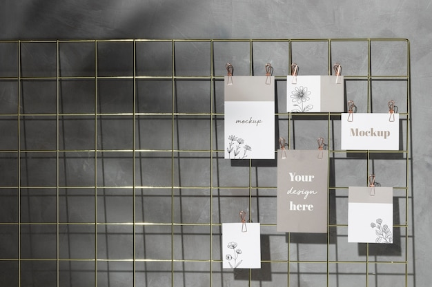 Set of cards hanging on grid memo board with clips Premium Psd