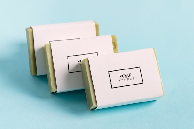 Set from handmade herbal natural soap bar on a pastel blue background. mock-up Premium Psd